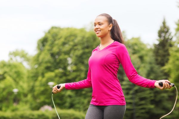 fitness, sport, training, park and lifestyle concept - smiling african american woman exercising with jump-rope outdoors; Shutterstock ID 206547886; PO: TODAY.com