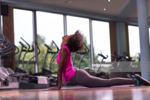 beautiful young african american woman exercise yoga in gymbeautiful young african american woman exercise yoga in gym